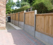 Sturdy double gravel boarded fence, acts as part retaining wall
